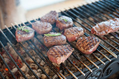 Marbled veal steaks are toasted on the grill Royalty Free Stock Photo