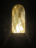 Old marbled window in crypt Stock Photography
