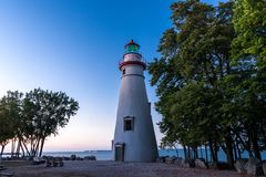 Marblehead lighthouse in Ohio. View of Marblehead lighthouse and it's surrounding landscape with Lake Erie visible beyond, located in Marblehead, Ohio (USA Royalty Free Stock Photography