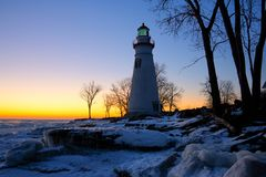 Marblehead Lighthouse in Ohio in Winter. Marblehead Lighthouse in Ohio at sunrise in winter at sunrise Stock Photo