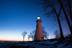 Marblehead Lighthouse in Ohio in Winter. Marblehead Lighthouse in Ohio at sunrise in winter at sunrise with light on Royalty Free Stock Images
