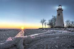 Marblehead Lighthouse Sunrise. The historic Marblehead Lighthouse in Northwest Ohio sits along the rocky shores of the frozen Lake Erie. Seen here in winter with Royalty Free Stock Image