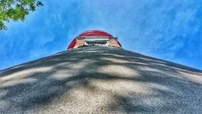 Marblehead lighthouse unique perspective. Sun, shade and unusual angle make for an interesting photograph of the Ohio lighthouse at Lake Erie stock images