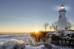 Marblehead Lighthouse Winter Sunrise. The historic Marblehead Lighthouse in Northwest Ohio sits along the rocky shores of the frozen Lake Erie. Seen here in Royalty Free Stock Images