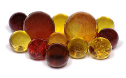 Marbles. A group of colorful red, orange, yellow, and brown glass marbles isolated on a white background Royalty Free Stock Photography