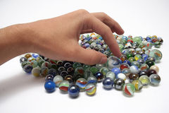 Marbles. Childhood game uses colorful glass marbles royalty free stock photo