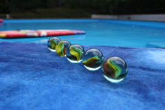Marbles. In line Royalty Free Stock Image