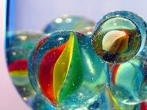 Marbles. In the wineglass Stock Photo