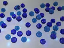 Marbles background. Flying 3d shiny blue marbles Royalty Free Stock Image