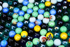 Marbles Background. A background of small coloured marbles Stock Images