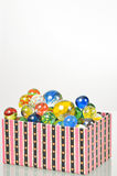 Marbles balls in box Stock Photography