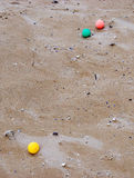 Marbles on the beach Royalty Free Stock Images