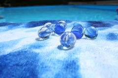 Marbles in the blue. Blue glass marbles Royalty Free Stock Images