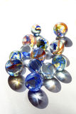 Marbles with blue swirls. Vertical orientation stock photo