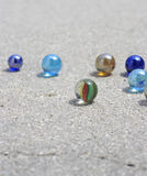 Marbles on concrete. Different colored marbles on concrete Royalty Free Stock Photography