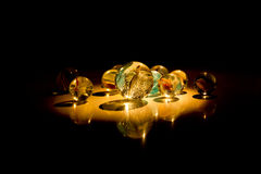 Marbles in the darkness Royalty Free Stock Photography