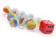 Marbles and die Royalty Free Stock Photography