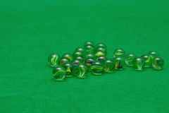 Marbles. Displayed on a green background Stock Photography