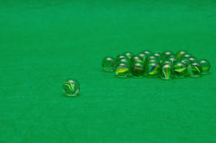 Marbles. Displayed on a green background Royalty Free Stock Image