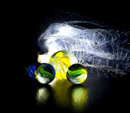 Marble objects nets stock photo. Beautiful marbles with white fishing nets background photograph Stock Photo