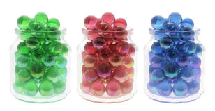 Marbles in Glass Jars Stock Photo