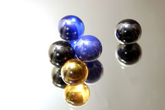 Marbles on Mirror Stock Photo