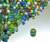 Marbles. Multi Coloured Glass Marbles on Mirror Stock Images