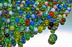 Marbles. Multi Coloured Glass Marbles on Mirror Stock Photography