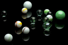 Marbles. Photo of color marbles on black with reflection Royalty Free Stock Photo