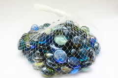 Marbles on pouch Royalty Free Stock Photos