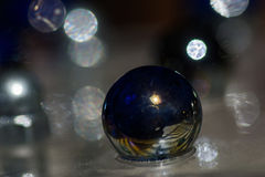 Marbles and reflections of reality Royalty Free Stock Image