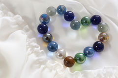 Marbles in shape of heart. Many marbles arrange in shape of heart.On the part of bridal gown Royalty Free Stock Photos