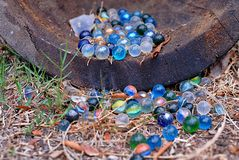 Marbles spilling out of a wood barrel stock photos