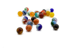 Marbles spread on white Royalty Free Stock Photos