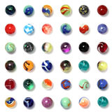 Marbles Collection. Collection of marbles arranged in a square isolated on a white background with base shadows stock images