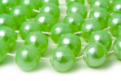 Marbles on a thread. Mineral deposit of beads on a white background Royalty Free Stock Photography