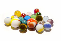 Marbles on white Stock Photos