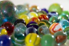 Marbles on white background stock photos