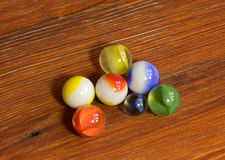 Marbles on Wood Royalty Free Stock Image