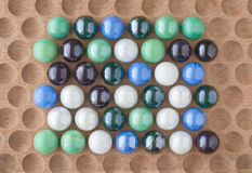 Marbles on Wood Royalty Free Stock Photo