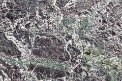 Marbre de marbrure texturisé rocailleux abstrait de fond Photographie stock libre de droits