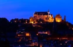 Marburg at Night. Marburg an der Lahn, Germany - August 7, 2015: Illuminated palace abd old town of Marburg at night Stock Images