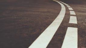 Marcação de estrada curvada branco da cidade Imagens de Stock