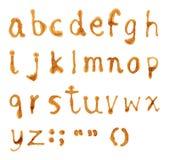 Marca del alfabeto del café manchada foto de archivo
