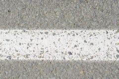 Marca en el asfalto Fotos de archivo libres de regalías