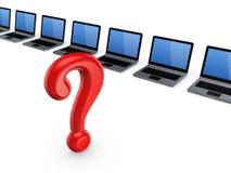 Marca roja de la pregunta contra los cuadernos. Imagenes de archivo