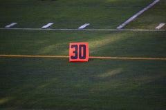 Marcador de yarda del campo de fútbol Imagenes de archivo