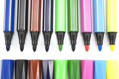 Marcadores coloreados en el fondo blanco Fotografía de archivo