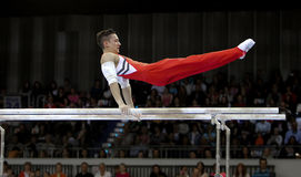 Marcel Nguyen. Germany's Marcel Nguyen on the parallel bars during a qualifying competition for the 2012 Olympic games in London England Stock Photos