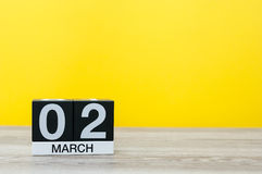 Free March 2nd. Day 2 Of Month, Calendar On Table With Yellow Background. Spring Time, Empty Space For Text Royalty Free Stock Photo - 87465895